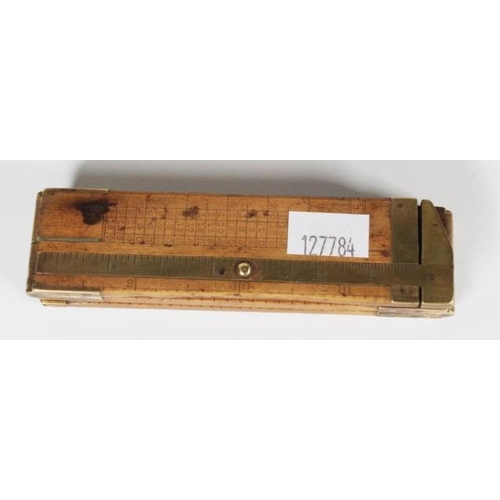 1333 - Antique trifold boxwood & brass ironmonger rule marked Rabone & Sons. (Length 12 inches)....