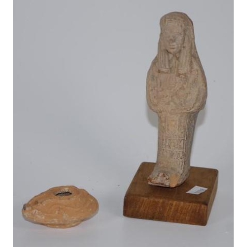 1338 - Two Egyptian archaic artifacts an Ushabti & oil lamp (5-6th Century) 16.5cm high (tallest) approx....