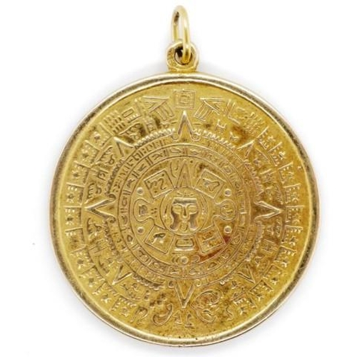 135 - Yellow gold Aztec calendar pendant marked 9ct approx 8.7 grams weight. Tests as 8ct...