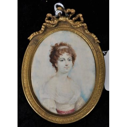 1354 - Antique French handpainted portrait of a lady painted on ivory, in a brass oval frame with a bow to ...