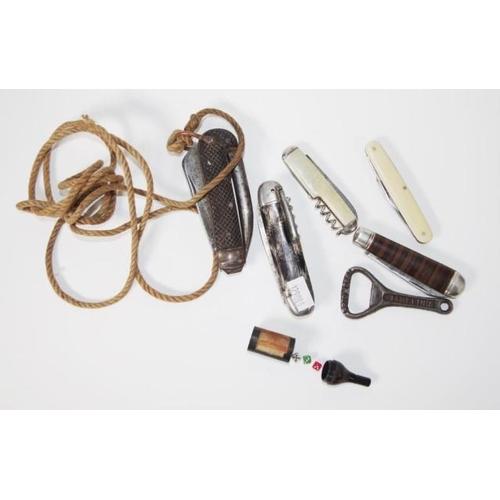 1366 - Five assorted pocket knives a cast iron bottle opener & a novelty dice holder...