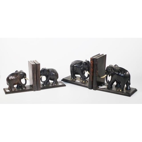 1376 - Two sets of ebony elephant bookends 36cm wide (largest) approx....
