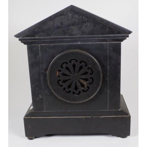 1404 - Vintage slate mantle clock black slate, decorated with carved hunting scene to pediment and brass co...