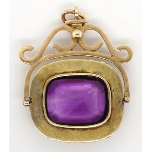 145 - Gold and amethyst spinner unmarked tests as 14ct spinner frame and 9ct brooch settings. Approx total...