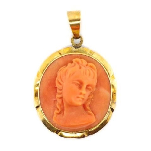 146 - A good carved coral and 14ct gold pendant with a well carved picture of a lady, marked to jump ring ...