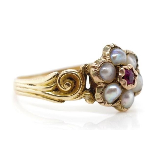 166 - Antique gold flower ring set with seed pearls and corundum. Unmarked approx 2.1 grams weight ring si...