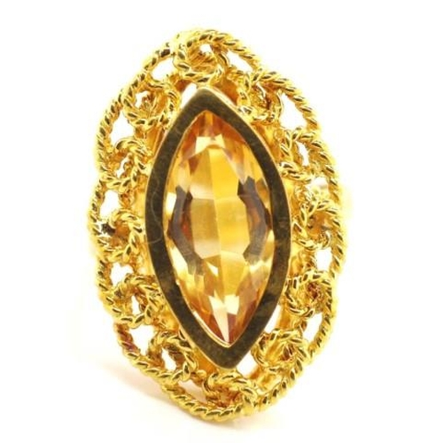 174 - Citrine and 18ct yellow gold ring set with a central navette cut stone with strip twist type borders...