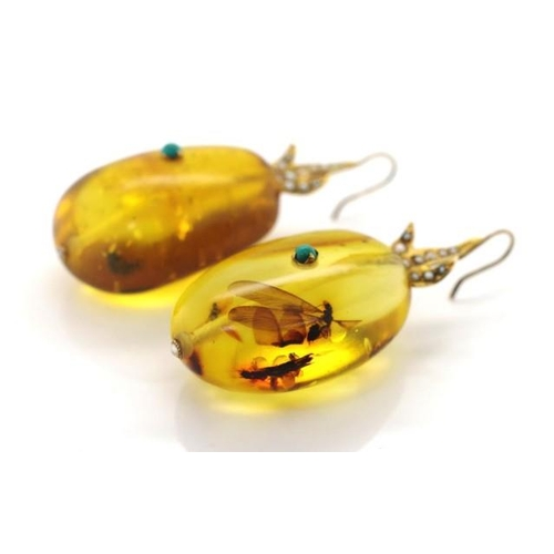 190 - A good pair of amber and 9ct gold earrings includes a good example of an insect inclusion. With 9ct ...