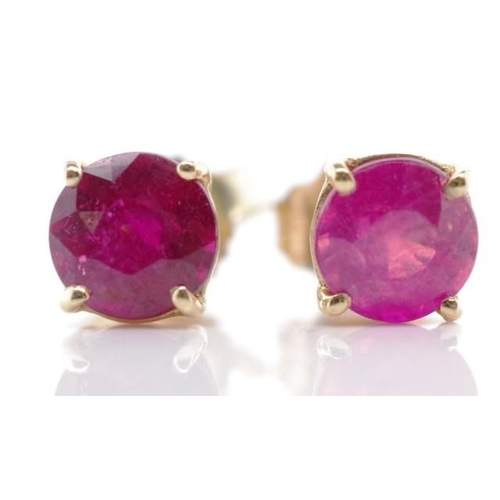 202 - Ruby and 10ct yellow gold stud earrings marked 10k approx 2x 4.5mm rubies...