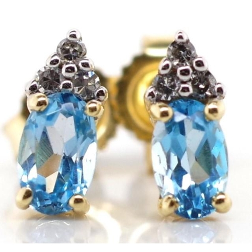 203 - Topaz and diamond and 14ct gold stud earrings marked 14k...