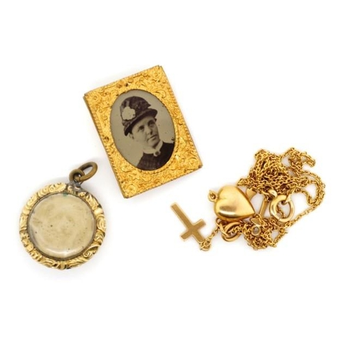 212 - 15ct gold chain and charms Approx chain weight 4 grams, together with a gilt mourning pendant and a ...