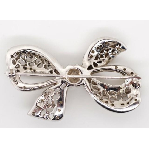 214 - Diamond and 14ct white gold bow brooch marked with makers mark. Approx brooch weight 13.5 grams, cen...