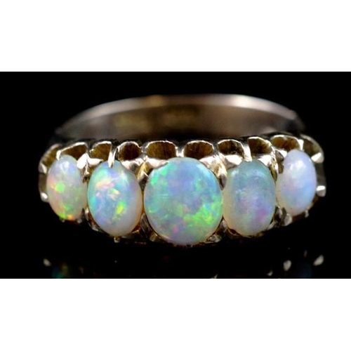 22 - Antique 12ct gold and five stone opal ring marked 12ct twice. Approx 3.2mm x 4.3mm - 4.5mm x 5.8mm c...