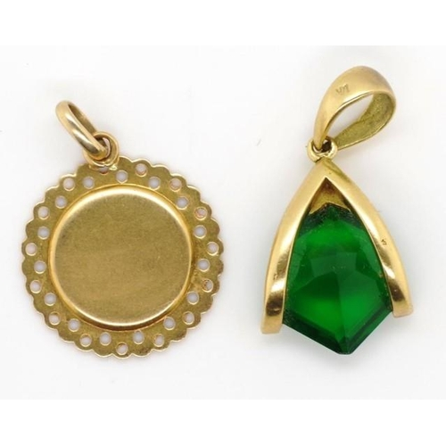 225 - Two gold pendants to include an unmarked Madonna and green gemstone pendant marked 18k. Total weight...