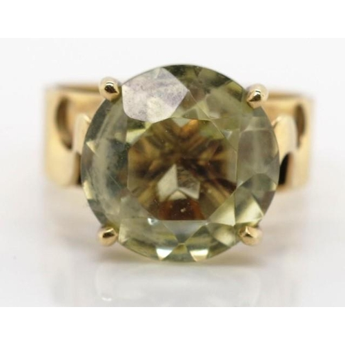 237 - 9ct yellow gold and lemon quartz ring marked 9ct approx lemon quartz 4.5ct, total ring weight 4.4 gr...