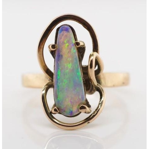238 - 9ct rose gold and opal ring marked 9ct approx white opal size 14mm x 5mm tapered drop cabochon. Tota...