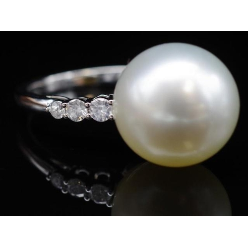 240 - South sea pearl, diamond and 18ct white gold ring marked 18k 750. Approx 12mm South sea pearl. 6x di...