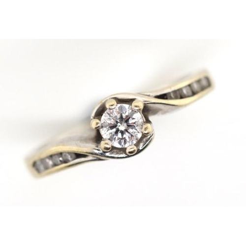 241 - Diamond solitaire and 18ct white gold ring raised six claw setting with eight channel set diamonds t...