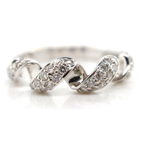 25 - 18ct white gold and diamond cluster ring of unusual spiral form with grain set white round brilliant...