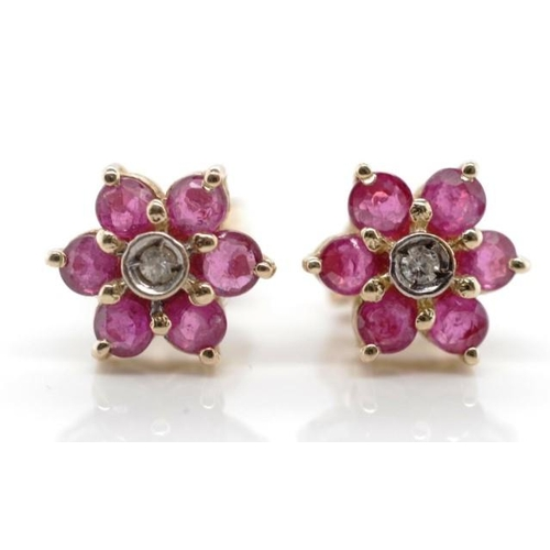 258 - Ruby, diamond and 14ct yellow gold earrings all set in a floral arrangement, marked 14k 585 to stud ...