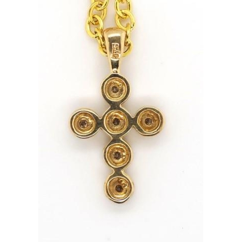 267 - 9ct yellow gold and diamond cross marked 375 approx weight 0.7 grams ex gold plate chain...