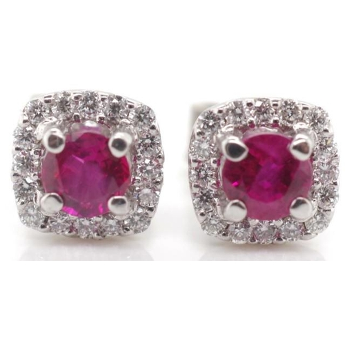 268 - 18ct gold, ruby and diamond halo earrings marked 750 to studs and butterfly backs approx 1.7 grams...