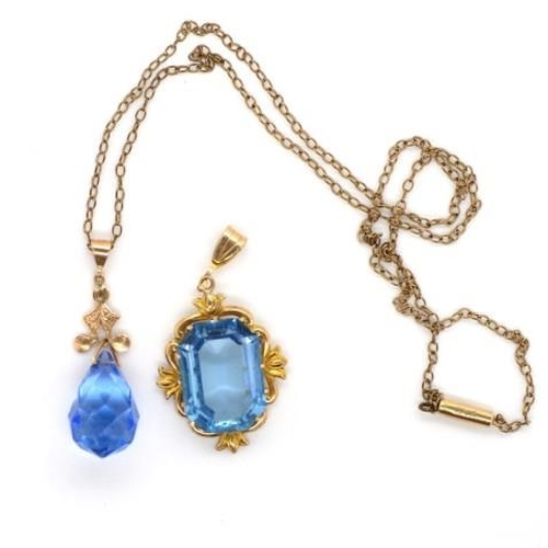 269 - Two 9ct gold pendants set with blue glass gemstones. One marked 9ct HP and the 9ct. Approx gilt meta...