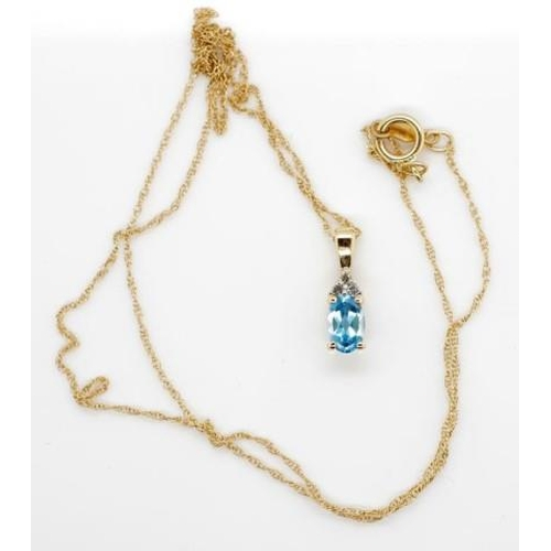 270 - Topaz and diamond 14ct gold pendant and chain Approx 6x4mm oval cut topaz with three round brilliant...