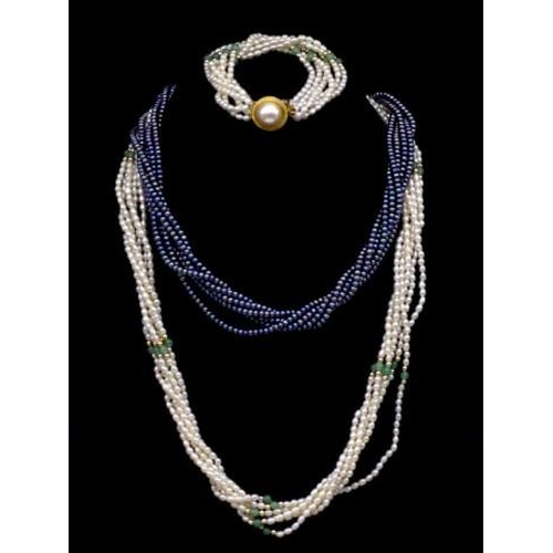 287 - A collection of pearl jewellery includes and white and a black necklace as well as a matching bracel...