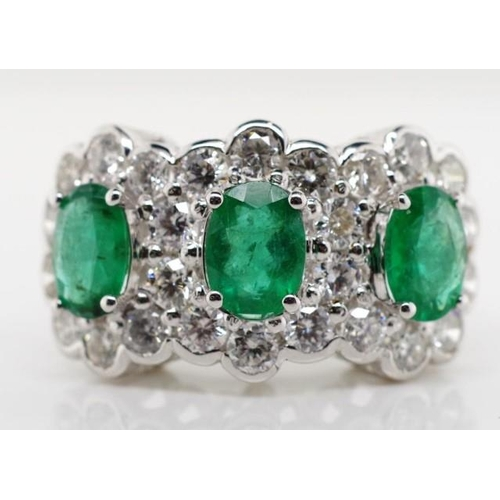 29 - Good emerald, diamond and 18ct gold ring approx three oval cut emeralds total weight 2.50ct. quality...