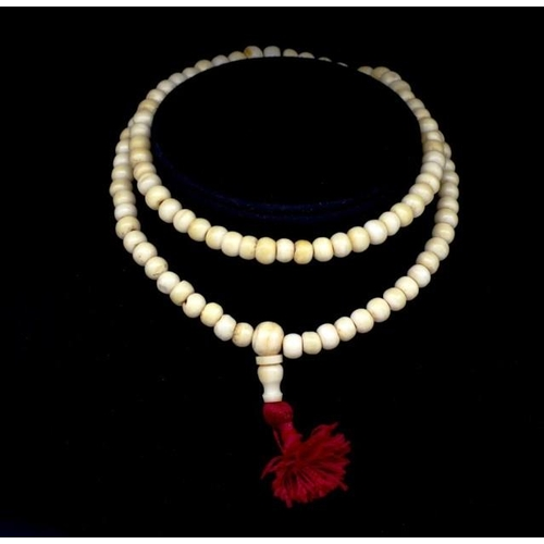 291 - Ivory beaded necklace C.1920s approx 7.7mm bead, 64cm length. This item may not be exported without ...