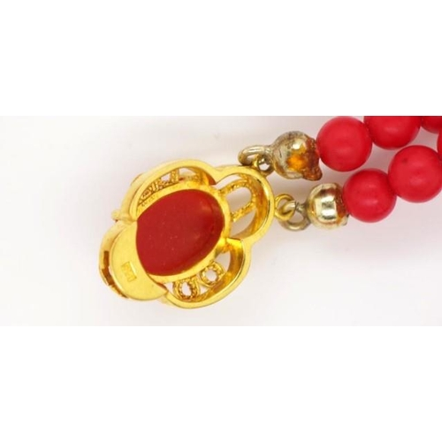 292 - Two strand coral and 14ct gold necklace marked 14k gold clasp approx 44cm length...