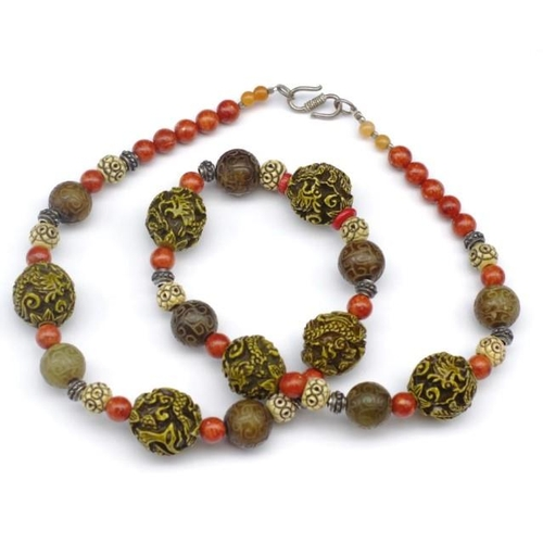 294 - Necklace of agate, coral, bone and silver with dragons...