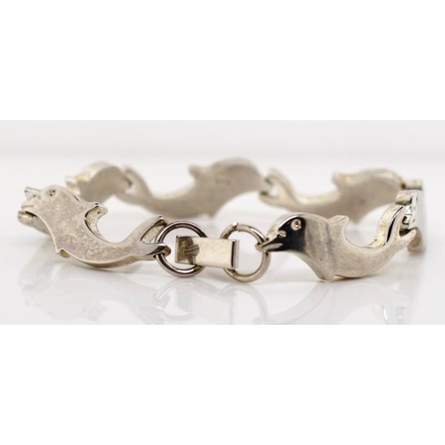 315 - A child's silver dolphin bracelet marked 925 approx length 15cm...