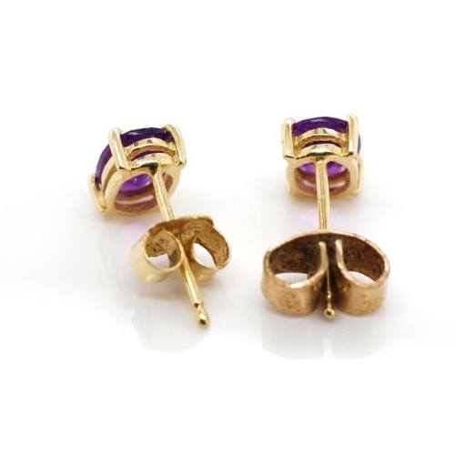 326 - 14ct yellow gold and amethyst stud earrings marked 14k 585 approx 1 grams weight...