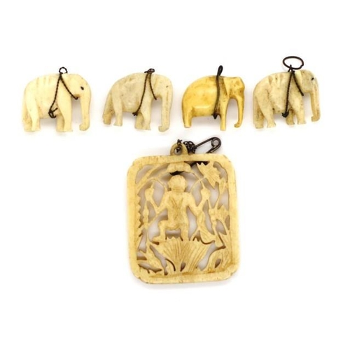 328 - A group of carved Asian ivory circa 1940s with pierced work panel and four elephant charms. This ite...