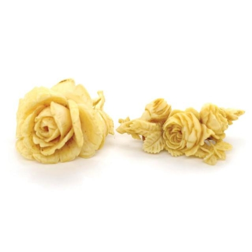 329 - Two well carved Ivory brooches circa 1930s of rose flower form. *One missing it's pin. This item may...