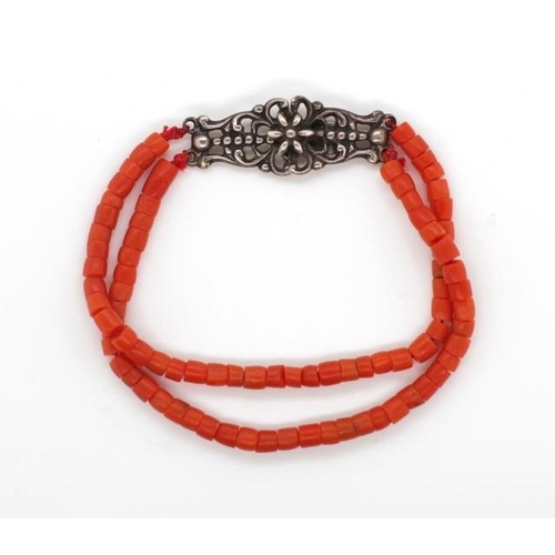 330 - Two Coral bracelets one with a Dutch silver clasp and another with a gold clasp rubbed marks....