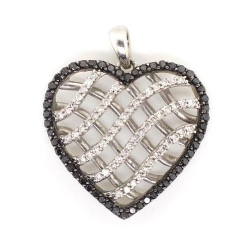 336 - Black and white diamond set 9ct gold pendant open heart form white gold setting. Marked 375 approx w...