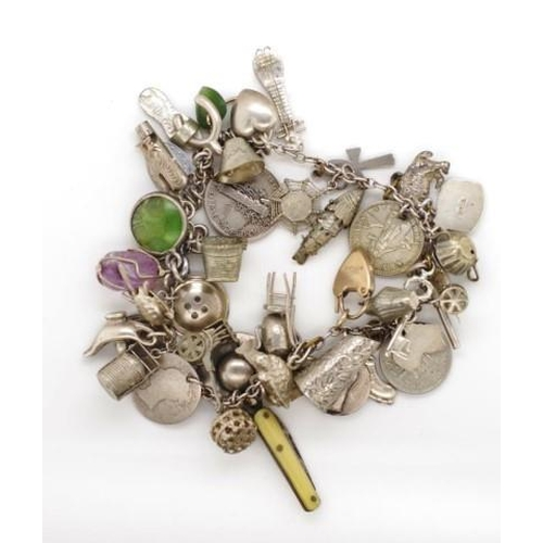 361 - Silver charm bracelet with marked silver charms, approx 41 grams weight...