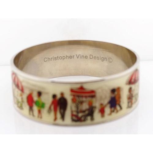 365 - Enamel bangle by Christopher VIne showing Paris scenes. Approx size 70mm inside width...