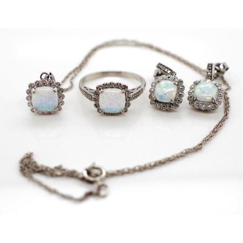 374 - Sterling silver diamond jewellery set reconstituted or synthetic opals with a diamond halo. Ring, st...