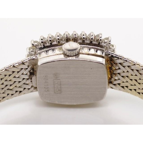 394 - 14ct white gold and diamond ladies watch Dial marked Dugena marked 585 to back plate and clasp Appro...