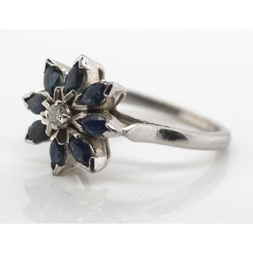 408 - Sapphire, diamond and silver ring navette cut  sapphires set in a around a single diamond in a flora...