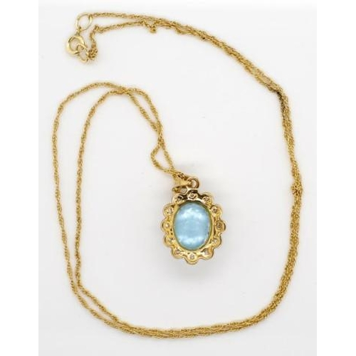 409 - 9ct gold, diamond and topaz pendant and chain marked 375 to chain and Birmingham 375 LA to pendant. ...