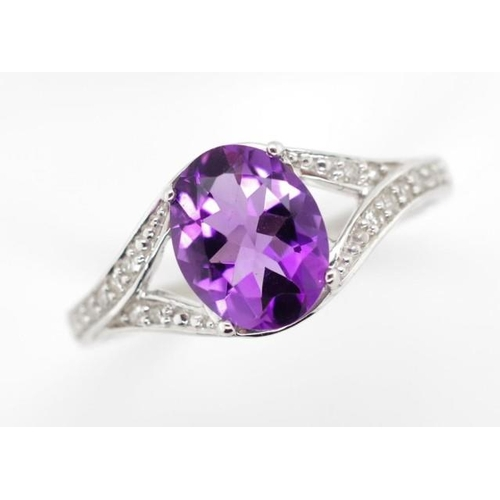 410 - Amethyst, diamond and 9ct white gold ring Marked London 375 SG. approx 2.7 grams total. Ring size N...