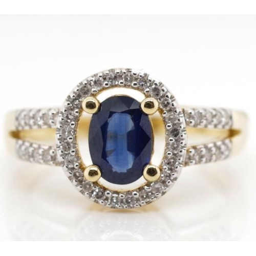 412 - Sapphire, diamond and 14ct gold halo ring marked 14k approx 3.47 grams, ring size N...