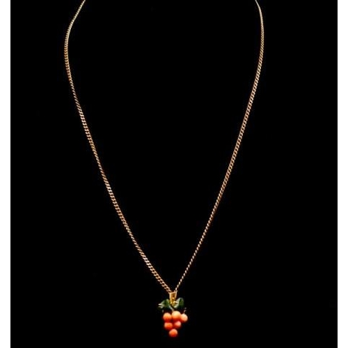 43 - Coral and jade pendant on 9ct yellow gold chain curb link marked 375 Italy. Approx chain length 54cm...