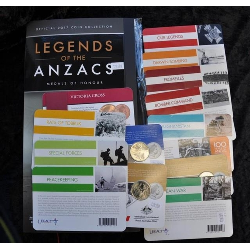 435 - Fourteen ANZAC Commemorative coins and 2 associated coin holders...