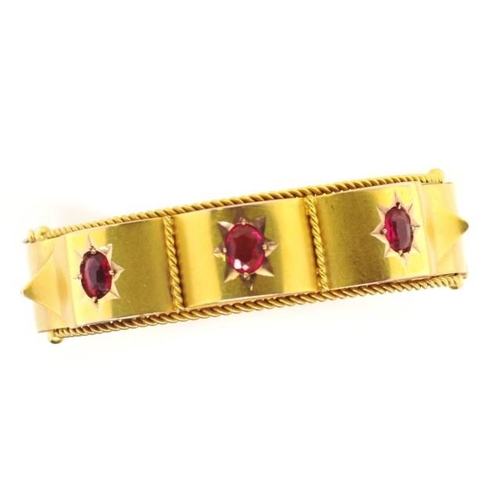 44 - Antique Australian 9ct gold bangle Set with three garnets, rope twist borders. With box clasp, hinge...